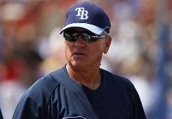 Tampa Bay Rays manager Joe Maddon takes in the action as his squad faces the Toronto Blue Jays in a spring training game. The Rays skipper is convinced his team has what it takes to build on last year's success.