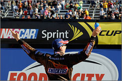 Kyle Busch soaks in the scene in Victory Lane at Bristol Motor Speedway after his second win of the season.