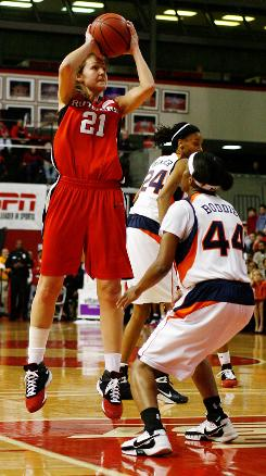 Rutgers forward Heather Zurich shoots over Tigers guard Whitney Boddie in the seventh-seeded Scarlet Knights' 80-52 thumping of No. 2 seed Auburn.