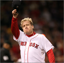 Red Sox hurler Curt Schilling tips his cap to the Fenway Park crowd after leaving Game 2 of the 2007 World Series.