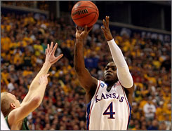 Kansas point guard Sherron Collins averages 18.9 points a game for the defending champions.