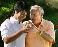 Japanese teen Ryo Ishikawa,  chatting with  golf  legend Arnold Palmer after a news conference in Orlando, said his invitation to play in this weekend's Arnold Palmer Invitation will &quot;be my lifetime treasure.&quot; 