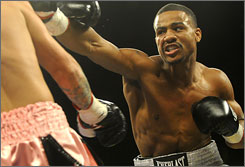 Olympic bronze medalist Andre Dirrell, right, knocked out Mike Paschall in the third round in a middleweight bout in August.