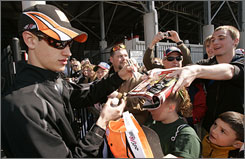 Joey Logano signs autographs for fans outside of Bristol Motor Speedway before last Sunday's 500-lapper.