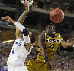 Memphis' Roburt Sallie has his shot blocked by Missouri's J.T. Tiller during the first half in Glendale, Ariz. Though Memphis sliced Missouri's 24-point lead down to seven, Tiller and Mizzou held on for the Sweet 16 victory.