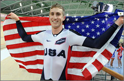 American Taylor Phinney poses with the American flag after winning the world championship in the individual pursuit race on Thursday.