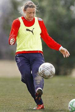 Abby Wambach of the Washington Freedom kicks the ball during practice in Boyds, Md. She will be on the field when the Women's Professional League kicks off its season on Sunday.