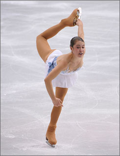 Alissa Czisny, performing her routine Friday at the World Figure Skating Championships, fell on her triple flip and stumbled on her double axel in her short program routine.