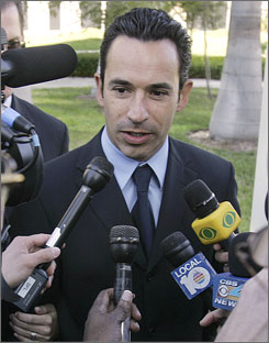 Race car driver Helio Castroneves is accused of failing to pay $2.3 million in taxes.
