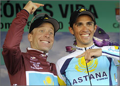 Levi Leipheimer and Alberto Contador goof around on the podium while celebrating Leipheimer's race win in Spain.