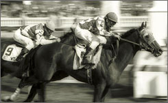 Alysheba outran Bet Twice at Churchill Downs in 1987 to win the Kentucky Derby in 2:03.