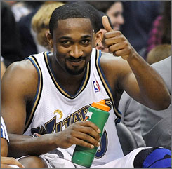 Wizards guard Gilbert Arenas gives a thumbs-up while sitting on the bench against the Pistons. Arenas scored 15 points and dished 10 assists but Richard Hamilton poured in 31 points as Detroit won 98-96 in Washington.