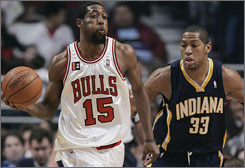 Bulls forward John Salmons looks for a passing lane past Pacers defender Danny Granger during a first-quarter possession.