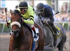 Quality Road, with John Velazquez up, heads toward the finish line Saturday with Dunkirk trailing.