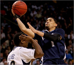 Scottie Reynolds take a shot in the lane during Villanova's battle with Pitt in the East Regional final. Reynolds hit another shot in the lane in the game's final second that lifted the Wildcats to their first trip to the Final Four since 1985.