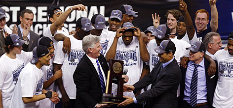 The Villanova Wildcats celebrate as coach Jay Wright is presented the East Regional trophy after the Wildcats upended Pitt on Saturday in Boston.
