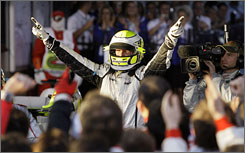 Jenson Button celebrates his second Formula One victory after leading the Brawn GP team to a winning debut in Australia.