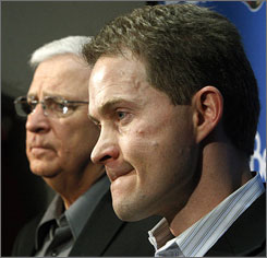 Bryan Murray, left, introduced Cory Clouston as Ottawa Senators coach on Feb. 2. Clouston has installed a puck-pressure system.
