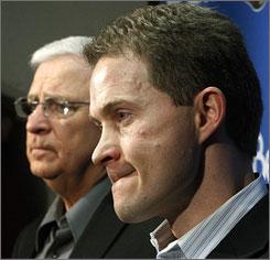 Bryan Murray, left, introduced Cory Clouston as Ottawa Senators coach on Feb. 2. Clouston has installed a puck-pressure system.