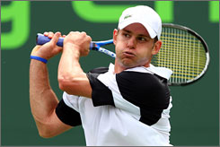 Andy Roddick folllows through on a backhand during his straight-set victory over Dmitry Tursunov at the Sony Ericsson Open.