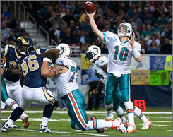 The Dolphins selected Jake Long, shown blocking for Chad Pennington, with the first pick in last year's draft. Long became a Pro Bowler as a rookie.