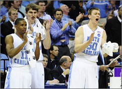 North Carolina's Larry Drew II, left, Tyler Zeller and Tyler Hansbrough celebrate from the bench as the Tar Heels pulled away from Oklahoma in the first half.