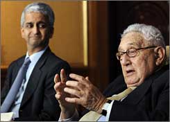 U.S. Soccer President Sunil Gulati, left, watches World Cup bid committee colleague Henry Kissinger answer questions Monday in New York.