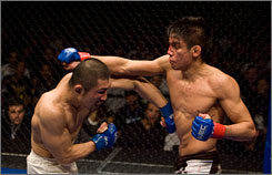 Bantamweight champ Miguel Torres, right, fighting Yoshiro Maeda last year, is on a WEC card Sunday in the Windy City.