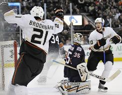 Ducks defenseman Sheldon Brookbank celebrates his goal past Oilers goalie Dwayne Roloson. Anaheim topped Edmonton 5-3.