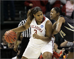 Oklahoma center, Courtney Paris backing down Purdue center Danielle Campbell, had 19 points, 13 rebounds and six blocks as the Sooners edged Purdue 74-68 to earn a berth in the Final Four.