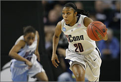 Connecticut point guard Renee Montgomery pushes the ball up court on a fast break during the first half against Arizona State. Montgomery scored 22 points as the undefeated Huskies won 83-64.