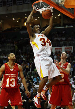 Georgia Tech recruit Derrick Favors slams in two of his 19 points during the McDonald's All-American game. Favors' effort led the East to a 113-110 victory over the West.