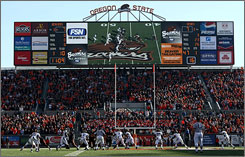 The scoreboard at Oregon State's Reser Stadium is framed in ads, part of an effort to boost income for the school. Other schools have gone beyond advertisements for revenue purposes by selling naming rights to stadiums and arenas.