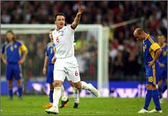 John Terry celebrates his late goal to give England a 2-1 win over Ukraine.