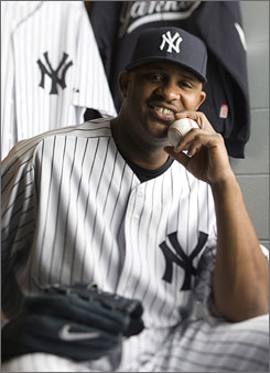 Left-hander CC Sabathia has plenty of reason to smile. He's one of three big-ticket acquisitions, along with Mark Teixeira and A.J. Burnett, by the Yankees.