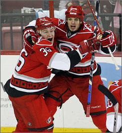 The Hurricanes'  Chad LaRose, right, celebrates with teammate  Jussi Jokinen after scoring the go-ahead goal to lift Carolina past the Rangers and into fourth place in the Eastern Conference playoff race.