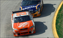 Joey Logano rounds a Martinsville Speedway turn ahead of A.J. Allmendinger during Sunday's 500-lapper.