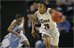 Renee Montgomery, Connecticut's four-year starter at point guard, averages 16.2 points and 5.1 assists for coach Geno Auriemma's undefeated squad.