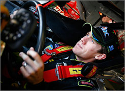 Carl Edwards gets buckled in before making practice runs at Texas Motor Speedway.