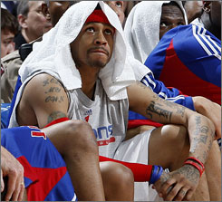 Pistons guard Allen Iverson watches from the bench during a Feb. 22 game against the Cavs.