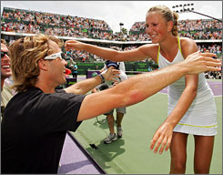 Victoria Azarenka gets a hug from her coach Antonio Van Grichen after defeating Serena Williams in the final of the Sony Ericsson Open.