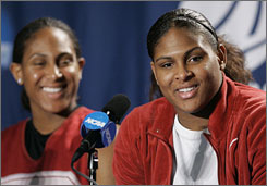 Oklahoma's Ashley Paris,left, will try to help sister Courtney and the Sooners beat Louisville Sunday night in the Final Four.
