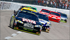 Jeff Gordon runs ahead of the pack on the frontstretch on the way to his first victory at Texas Motor Speedway.