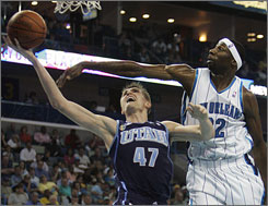 Jazz forward Andrei Kirilenko, left, goes to the basket in front of Hornets forward Julian Wright in the first half of Utah's win in New Orleans.