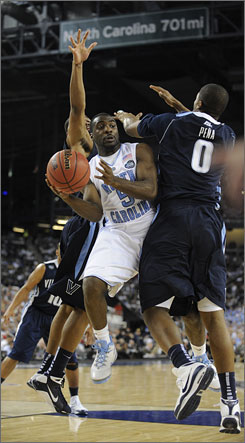 "North Carolina's Ty Lawson, trying to get past Villanova's Antonio Pena on Saturday, has benefited from his decision to stay in school. ""I just have more dedication than I've had in the past,"" he says."
