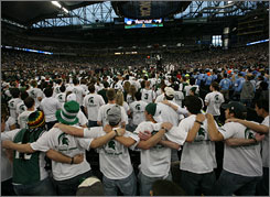 Michigan State fans stand together and cheer during the Spartans' victory over Connecticut in the semifinals on Saturday.