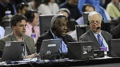 Former Georgetown coach John Thompson, center, has moved to the radio booth since leading the Hoyas to the 1984 National Championship, the first ever for a black head coach.