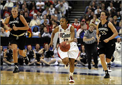 Connecticut point guard Renee Montgomery, pushing the ball up court during a fastbreak, led all scorers with 26 points in the Huskies' 83-64 win over Stanford.