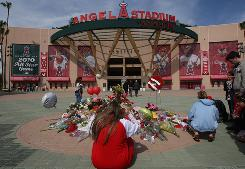  Fans gather around a makeshift memorial to Los Angeles Angels of Anaheim pitcher       Nick Adenhart outside Angel Stadium. Adenhart and two others were killed in car crash early this morning. 