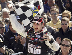 Jeff Gordon holds the checkered flag for the first time since October 2007 after Sunday's victory at Texas Motor Speedway.